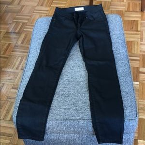 High rise black with sheen skinny jeans.